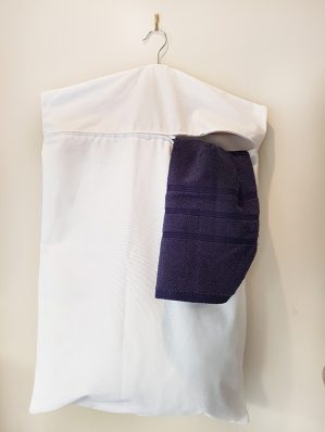 Hanging laundry bag with zip by Home & Yacht Linens and Interiors